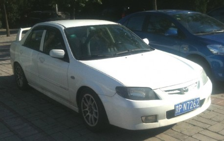 Mazda Familia with a Big Wing in China